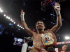 Manny Pacquiao gestures to fans celebrating after defeating Timothy Bradley Jr. in a 12 round unanimous decision at the MGM Grand Arena on April 9, 2016 in Las Vegas, Nevada.