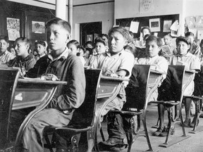 Residential schoolchildren in a typical classroom.