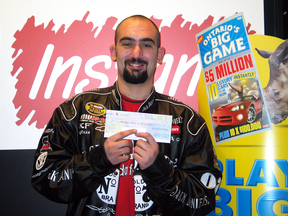 Daniel Carley of St. Catharines. Ont., collects his $5-million prize from a winning instant-win lottery ticket in 2006.