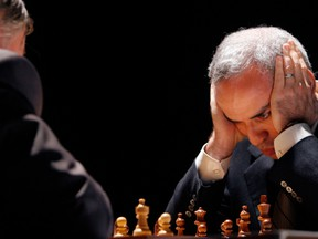 Garry Kasparov, right, and Anatoly Karpov, left, play an exhibition rematch in Valencia, Spain, in 2009.