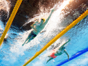 Mack Horton (left) and Sun Yang compete in the men's 400-metre freestyle final on Saturday.