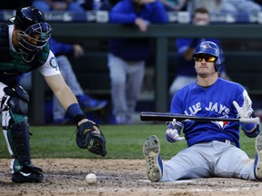 Josh Donaldson takes a break after being dusted by a close pitch on Sept. 21 in Seattle.
