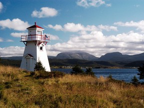 The Woody Point Lighthouse is surrounded by Gros Morne National Park, N.L.