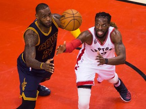 Cleveland's LeBron James (left) battles Toronto's DeMarre Carroll for a loose ball during playoff action in May 2016.