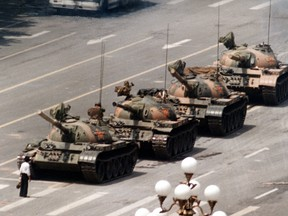 In this June 5, 1989 file photo, a Chinese man stands alone to block a line of tanks heading east on Beijing's Cangan Blvd.