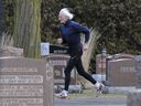 Ed Whitlock runs in a cemetery near his home in Milton, Ont.