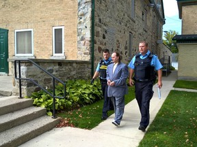 Anthony Edward Ringel, 47, is led away to jail after pleading guilty Tuesday, Oct. 11 in Walkerton to second degree murder in the death of Christine Harron more than 23 years ago.