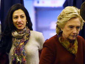 Hillary Clinton with longtime aide Huma Abedin onboard her plane in October 2016.
