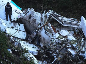 Rescue teams work in the recovery the bodies of victims of the LAMIA airlines charter that crashed in the mountains of Cerro Gordo, municipality of La Union, Colombia, on November 29, 2016