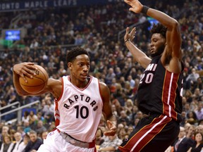 DeMar DeRozan of the Raptors drives to the basket around Miami Heat's Justise Winslow during the first half of their game on Friday night in Toronto.