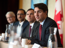 Prime Minister Justin Trudeau speaks at a Long Term Investment Summit in Toronto as Finance Minister Bill Morneau and investors listen, Monday Nov. 14, 2016.