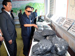 This undated handout picture, released from North Korea's official Korean Central News Agency on August 18, 2009 shows North Korean leader Kim Jong Il inspecting the Jikdong Youth Coal Mine.