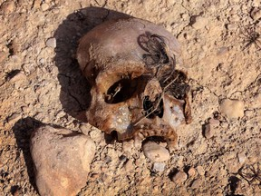 A mass grave containing the remains of members of the Yazidi community killed by ISIL discovered by Kurdish forces near the Iraqi village of Sinuni, in the northwestern Sinjar area on Feb. 3, 2015.