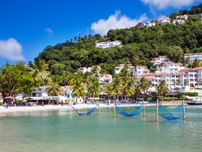 With its clear turqoUise waters and lush hillsides, Labrelotte Bay is one of the most scenic spots on St. Lucia.