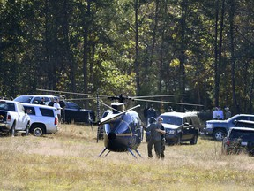 The Greenville County Sheriff's Office assists Spartanburg County investigators Friday, Nov. 4, 2016, as they work on the Wofford Road property in Woodruff, S.C
