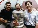 Cam Cole (left) sits with the Stanley Cup and Edmonton Journal colleagues Ray Turchansky (centre) and Jim Matheson in 1990.