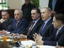 Israeli Prime Minister Benjamin Netanyahu, second right, attends a weekly cabinet meeting in Jerusalem, Sunday, Dec. 25.