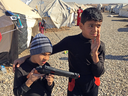 Mustafa and his brother, Ahmed, dressed entirely in black — the preferred uniform of ISIL jihadists.