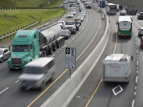 Vehicles are shown in Toronto on Monday June 29, 2015. It is long past time that Canada's congested cities began putting a price on some of their most precious real estate, says a new report from Canada's Ecofiscal Commission. THE CANADIAN PRESS/Frank Gunn