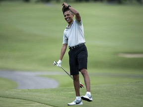 Obama arrives on the 18th hole of the Mid-Pacific Country Club's golf course December 21, 2015 in Kailua, Hawaii