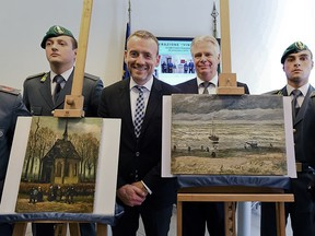 In this Friday, Sept. 30, 2016 file photo, Director of Amsterdam's Van Gogh Museum Axel Rueger, center, stands next to the paintings 'Congregation Leaving The Reformed Church of Nuenen', left, and 1882 'Seascape at Scheveningen' by Vincent Van Gogh, during a press conference in Naples, Italy.
