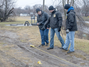 Jeff Schrier/The Saginaw News via AP measure tire tracks on Tuesday, Jan 24, 2017, near the scene of the shooting of Demarlon Thomas, 31, in Saginaw .