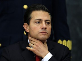 Mexico's President Enrique Pena Nieto pauses during a press conference at Los Pinos presidential residence in Mexico City, Monday, Jan. 23, 2017