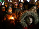 People gather in Edmonton to honour victims of a deadly shooting at a Quebec City mosque, Jan. 30, 2017.