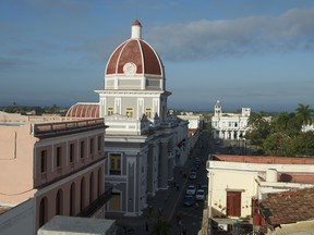 Skyline of the port city of Cienfuegos from the rooftop bar of La Union Hotel. Years of conflict and neglect are evident in the harsh morning light.