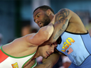 In this May 19, 2016 file photo, Iran's Pehman Yarahmadi, bottom, grapples with Jordan Burroughs of the United States in a 163-pound match during the Beat the Streets wrestling exhibition in New York.