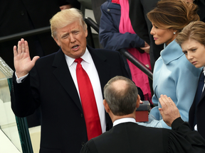President Donald Trump is sworn in by Supreme Court Chief Justice John Roberts in front of the Capitol in Washington.