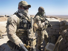 Canadian special forces look over a Peshmerga observation post, Monday, February 20, 2017 in northern Iraq.
