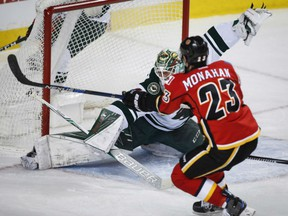 Minnesota Wild goalie Devan Dubnyk lets in a goal from Calgary Flames centre Sean Monahan during the first period in Calgary on Wednesday.