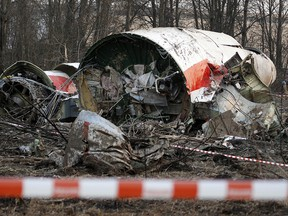 This is a Sunday, April 11, 2010 file photo of the wreckage of the Polish presidential plane which crashed early Saturday in Smolensk, western Russia.  A Polish court  Tuesday June 21, 2016 has convicted and handed a suspended prison term to Pawel Bielawny a former deputy head of government security over the 2010 plane crash that killed President Lech Kaczynski and 95 others.