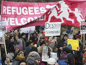 Trump's immigration policy brings out thousands of demonstrators to protest in front of the U.S. Embassy in Toronto on Feb. 4, 2017.