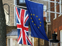 Flags of the United Kingdom and the European Union fly side by side in London on March 13, 2017