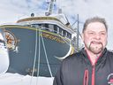 Theodore Genge in front of the KMKA Voyager in Anchor Point.