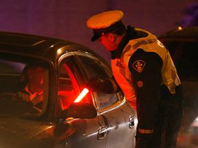 A police officer interviews drivers during a ride program. The ruling in the Kimberley McLachlan case has set a new precedent for drunk-driving cases in the Ontario Court of Justice.