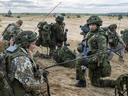 Canadian and Latvian soldiers in Kadaga, Latvia, during Operation Reassurance in September 2015.