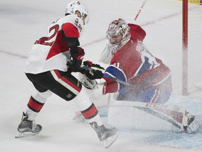 Chris Kelly of the Ottawa Senators is foiled by Montreal Canadiens' goaltender Carey Price during NHL action Sunday in Montreal. Price and the Canadiens were 4-1 winnes as they swept a weekend home-and-home set against the Senators in the battle for supremacy in the NHL's Atlantic Division.