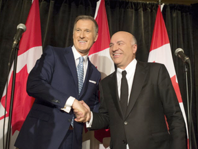 Kevin O'Leary, right, announces at Toronto's Royal York Hotel that he is stepping out of the Conservative leadership race and is backing fellow nominee Maxime Bernier.