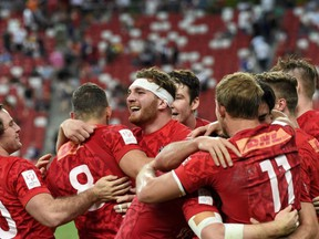 Canadian players celebrate winning the Singapore rugby sevens series tournament on April 16.