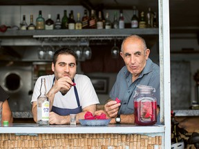 """Israeli chef Tomer Amedi, left, who grew up in a """"fairly traditional"""" Jewish home in Jerusalem, says his Kurdish father, right, and Moroccan mother are both amazing cooks."""
