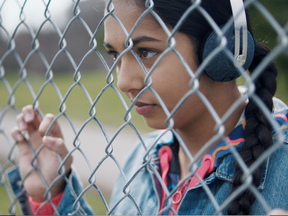 The star of the CFL's new TV spot is a 13-year-old girl who wanders by a pick-up game of flag football.