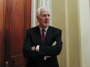 Senate Majority Whip John Cornyn of Texas, pauses as he speaks to reporters outside his office on Capitol Hill in Washington, Monday, June 26, 2017. Several Senate Republicans could scuttle the party's latest proposal to reform the American health care system.