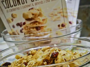 Creative Coconut Snacks is unveiled at a press preview as the 2017 Sofi specialty foods new product winner in the snacks category, Thursday, June 22, 2017, in New York. The product is among thousands of food and beverage items from more than 2,600 food artisans, importers and entrepreneurs from the around the globe at the annual Summer Fancy Food Show at the Javits Center. (AP Photo/Bebeto Matthews)