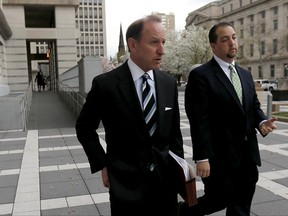 FILE- In this April 22, 2015, file photo, Abbe Lowell, left, attorney for U.S. Sen. Bob Menendez, walks out of Martin Luther King Jr. Federal Court with Menendez' press secretary Steve Sandberg following a pretrial hearing for the senator in Newark, N.J. Jared Kushner, the son-in-law of President Donald Trump, has picked Lowell to represent him in Russia-related investigations before Congress and Special Counsel Robert Mueller. Kushner has not been accused of wrongdoing, and there's no indication he's at risk of being charged. (AP Photo/Julio Cortez, File)