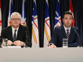 Inquiry Commissioner Leo Barry (left) and Justice Minister Andrew Parsons hold a news conference in St.John's on Tuesday, June 27, 2017 after the release of a public inquiry report into the police shooting of Newfoundland man Donald Dunphy. THE CANADIAN PRESS/Paul Daly