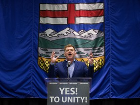 Brian Jean gives a speech after it was announced that the Wildrose party had voted in favour of uniting with the Progressive Conservatives in Red Deer on July 22, 2017.