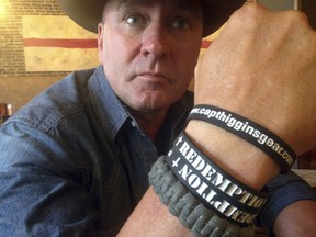 """FILE- In this June 2, 2016, file photo, Clay Higgins, a former Captain for the St. Landry Parish Sheriff's office, and candidate for Congress, poses for a photograph in Lafayette, La. The Louisiana congressman is apologizing for the """"unintended pain"""" caused by a video of his visit to a gas chamber at a Nazi concentration camp. Higgins said in an email Wednesday that he's retracting the video, recorded at the Auschwitz camp in Poland that is now part of the Auschwitz-Birkenau Memorial and Museum. (AP Photo/Kevin McGill, File)"""